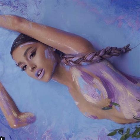 Ariana Grande strips completely topless for God Is A Woman