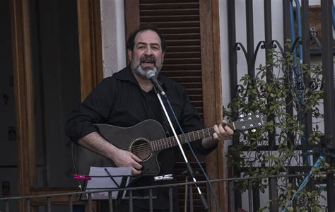 Italians have begun singing from their windows amid
